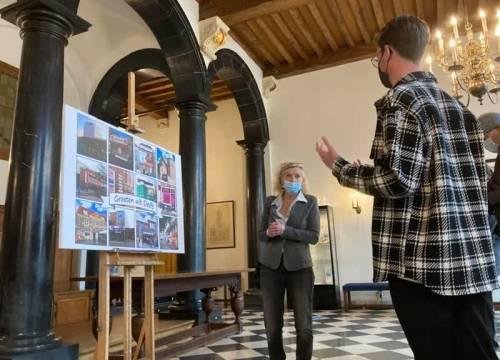Dreigende bezuinigingen leiden tot 'Groeten uit Delft'